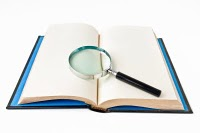 magnifying-glass-on-book